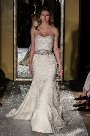NEW YORK, NY - OCTOBER 09: A model walks the runway wearing Oleg Cassini Fall 2015 Bridal collection at the Plaza Athenee on October 09, 2014 in New York City.
