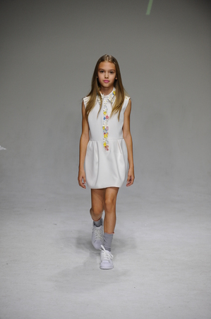 bonnie: NEW YORK, NY - OCTOBER 19: A model walks the runway during the Bonnie Young preview at petitePARADE Kids Fashion Week at Bathhouse Studios on October 19, 2014 in New York City.