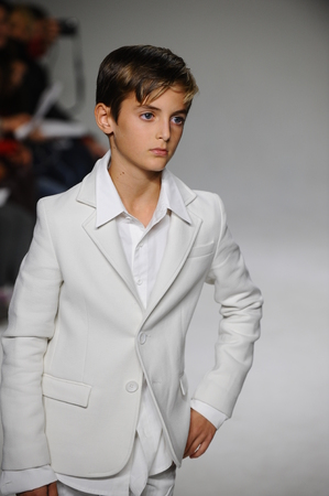 bonnie: NEW YORK, NY - OCTOBER 19: Brando Babini walks the runway during the Bonnie Young preview at petitePARADE Kids Fashion Week at Bathhouse Studios on October 19, 2014 in New York City. Editorial