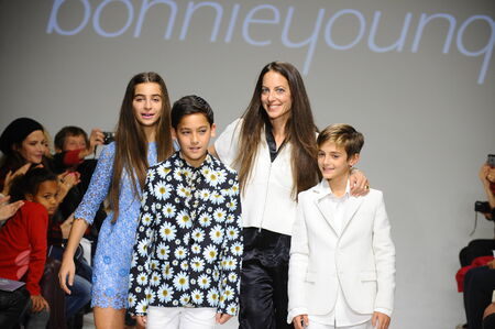 cahill: NEW YORK, NY - OCTOBER 19: Designer Bonnie Young poses with Celia Babini, Kyah Cahill and Brando Babini on the runway during the Bonnie Young preview at petitePARADE Kids Fashion Week on October 19, 2014 in NYC.