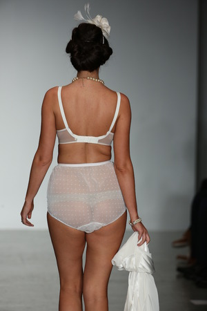 NEW YORK, NY - OCTOBER 24: A model walks runway wearing Secrets in Lace lingerie Spring 2015 collection at the Center 548 on October 24, 2014 in New York City.