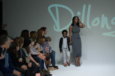 NEW YORK, NY - OCTOBER 19: Designer Latoia Fitzgerald walks the runway with a model during the Dillonger preview at petitePARADE Kids Fashion Week at Bathhouse Studios on October 19, 2014 in New York City.