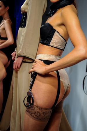 bdsm handcuff: NEW YORK, NY - OCTOBER 25: Models pose sexy during Love Cage Spring 2015 lingerie presentation at the Center 548 on October 25, 2014 in New York City.