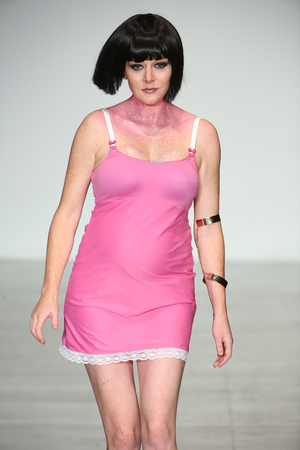 NEW YORK, NY - OCTOBER 25: A pregnant model walks runway during You! Lingerie Spring 2015 show during Lingerie Fashion Week at the Center 548 on October 25, 2014 in New York City. Editorial