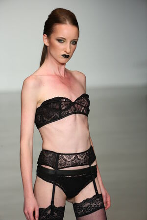 finale: NEW YORK, NY - OCTOBER 25: A model walks runway at Finale Runway Show during Lingerie Fashion week closing benefit Spring 2015 collections at the Center 548 on October 25, 2014 in New York City.