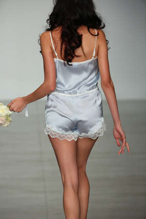 light blue lingerie: NEW YORK, NY - OCTOBER 25: A model walks runway at Finale Runway Show during Lingerie Fashion week closing benefit Spring 2015 collections at the Center 548 on October 25, 2014 in New York City.