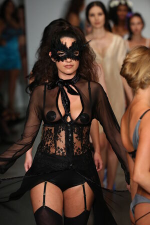 lyn: NEW YORK, NY - OCTOBER 25: Models walk runway at Finale Runway Show during Lingerie Fashion week closing benefit Spring 2015 collections at the Center 548 on October 25, 2014 in New York City. Editorial