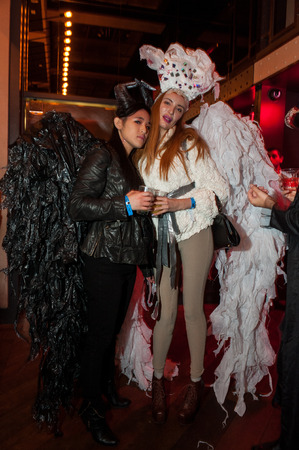 NEW YORK, NY - OCTOBER 31: Guests in mascarade costumes posing at The Fashion Party during Halloween event at the Venue 409 on October 31, 2014 in New York City.