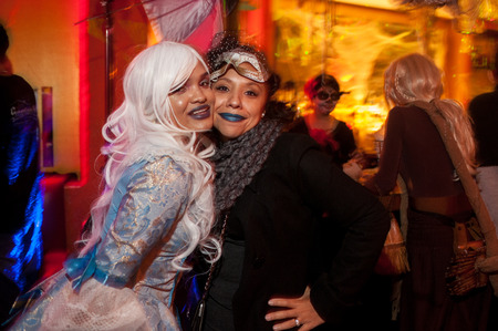 NEW YORK, NY - OCTOBER 31: Guests in mascarade costumes posing at The Fashion Party during Halloween event at the West Village Crema Restaurant on October 31, 2014 in New York City.