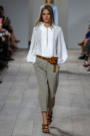 NEW YORK, NY - SEPTEMBER 10: A model walks the runway at Michael Kors during Mercedes-Benz Fashion Week Spring 2015 at Spring Studios on September 10, 2014 in New York City. Editorial