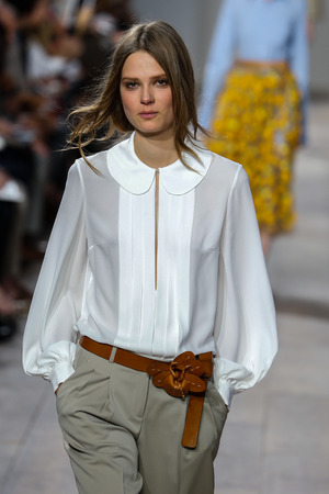 capri pants: NEW YORK, NY - SEPTEMBER 10: A model walks the runway at Michael Kors during Mercedes-Benz Fashion Week Spring 2015 at Spring Studios on September 10, 2014 in New York City. Editorial