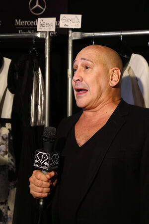 interviewed: NEW YORK, NY - SEPTEMBER 05: Designer Carmen Marc Valvo is interviewed backstage at the Carmen Marc Valvo 25th Anniversary show during MBFW Spring 2015 at Lincoln Center on September 5, 2014 in NYC