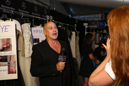 NEW YORK, NY - SEPTEMBER 05: Designer Carmen Marc Valvo is interviewed backstage at the Carmen Marc Valvo 25th Anniversary show during MBFW Spring 2015 at Lincoln Center on September 5, 2014 in NYC