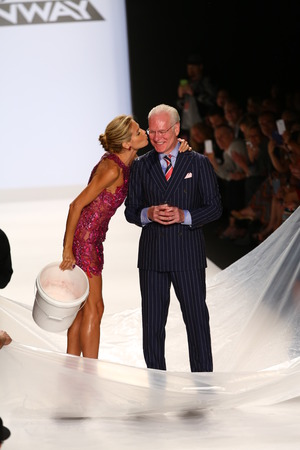 NEW YORK, NY - SEPTEMBER 05: Heidi Klum kiss Tim Gunn after ALS Ice Bucket Challenge at Project Runway during MBFW Spring 2015  on September 5, 2014 in NYC