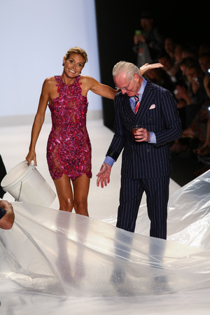 NEW YORK, NY - SEPTEMBER 05: Heidi Klum smiles at audience with Tim Gunn after ALS Ice Bucket Challenge at Project Runway during MBFW Spring 2015  on September 5, 2014 in NYC