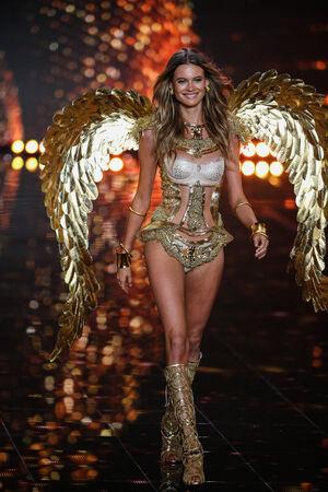 victoria secret: LONDON, ENGLAND - DECEMBER 02: Victorias Secret model Behati Prinsloo walks the runway during the 2014 Victorias Secret Fashion Show on December 2, 2014 in London, England.