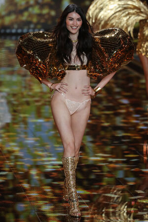 he: LONDON, ENGLAND - DECEMBER 02: Victorias Secret model Sui He walks the runway during the 2014 Victorias Secret Fashion Show on December 2, 2014 in London, England.