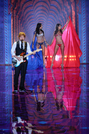 earls court: LONDON, ENGLAND - DECEMBER 02: Ed Sheeran performs on the runway at the annual Victorias Secret fashion show at Earls Court on December 2, 2014 in London, England. Editorial