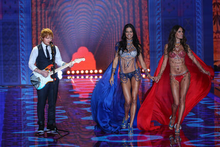 earls court: LONDON, ENGLAND - DECEMBER 02: Ed Sheeran performs as models walk the runway at the annual Victorias Secret fashion show at Earls Court on December 2, 2014 in London, England.
