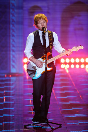 LONDON, ENGLAND - DECEMBER 02: Ed Sheeran performs on the runway at the annual Victorias Secret fashion show at Earls Court on December 2, 2014 in London, England. Editorial