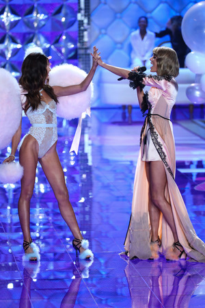 taylor: LONDON, ENGLAND - DECEMBER 02: Model Lily Aldridge (L) and singer Taylor Swift are seen on the runway during the 2014 Victorias Secret Fashion Show  on December 2, 2014 in London, England.
