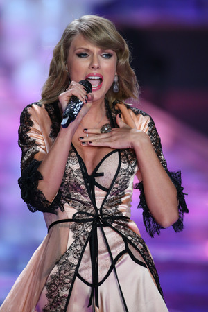 taylor: LONDON, ENGLAND - DECEMBER 02: Singer Taylor Swift performs on the runway during the 2014 Victorias Secret Fashion Show on December 2, 2014 in London, England.