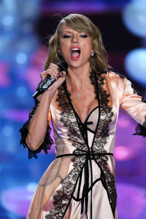 november 3d: LONDON, ENGLAND - DECEMBER 02: Singer Taylor Swift performs on the runway during the 2014 Victorias Secret Fashion Show on December 2, 2014 in London, England.