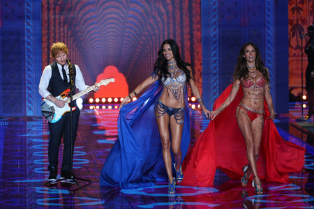 LONDON, ENGLAND - DECEMBER 02: Ed Sheeran performs as models walk the runway at the annual Victorias Secret fashion show at Earls Court on December 2, 2014 in London, England.