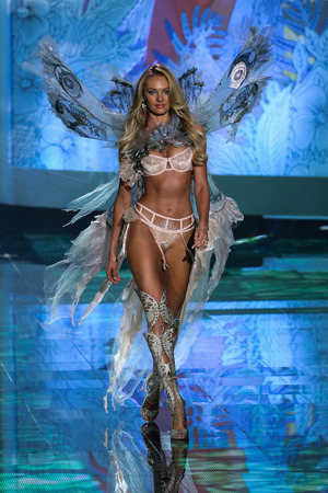 victoria secret: LONDON, ENGLAND - DECEMBER 02: Singer Hozier performs onstage as model Candice Swanepoel walks the runway during the 2014 VS Fashion Show on December 2, 2014 in London, England.