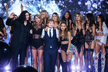 taylor: LONDON, ENGLAND - DECEMBER 02: Victorias Secret models pose with performers Hozier, Taylor Swift, Ed Sheeran and Ariana Grande during the 2014 VS Fashion Show on December 2, 2014 in London, England.