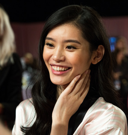 he: LONDON, ENGLAND - DECEMBER 02: Sui He backstage at the annual Victorias Secret fashion show at Earls Court on December 2, 2014 in London, England.