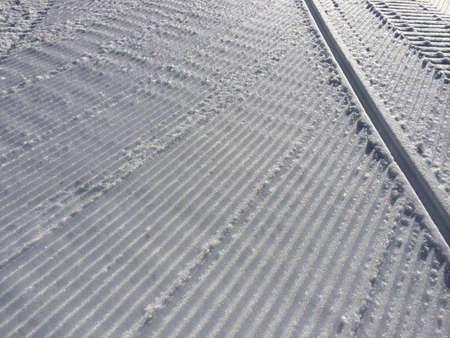 groomer: Fresh snow groomer tracks on a ski resort Stock Photo