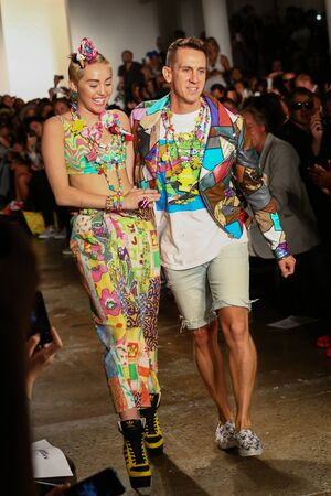 cyrus: NEW YORK, NY - SEPTEMBER 10: Miley Cyrus (L) and designer Jeremy Scott walk the runway during MADE Fashion Week Spring 2015 at Milk Studios on September 10, 2014 in NYC