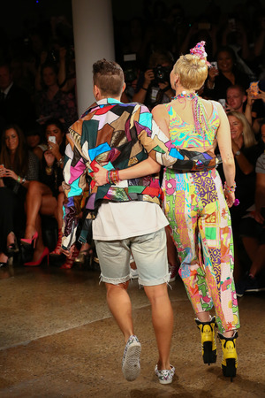 cyrus: NEW YORK, NY - SEPTEMBER 10: Miley Cyrus (R) and designer Jeremy Scott walk the runway during MADE Fashion Week Spring 2015 at Milk Studios on September 10, 2014 in NYC