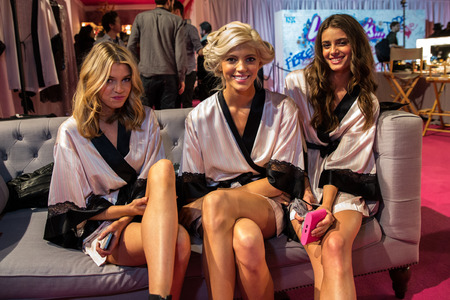 victorias secret show: LONDON, ENGLAND - DECEMBER 02: (L-R) Victorias Secret models Stella Maxwell, Shanina Shaik and Devon Windsor backstage at 2014 Victorias Secret Fashion Show on December 2, 2014 in London, England.