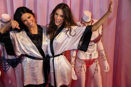 victorias secret show: LONDON, ENGLAND - DECEMBER 02: Adriana Lima(L) and Alessandra Ambrosio (R) pose backstage at the annual Victorias Secret fashion show on December 2, 2014 in London, England.