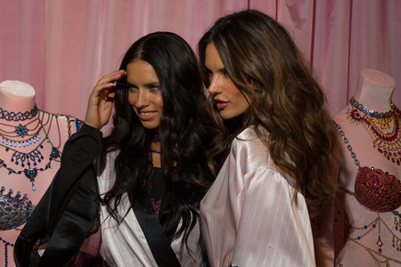 adriana: LONDON, ENGLAND - DECEMBER 02: Adriana Lima(L) and Alessandra Ambrosio (R) pose backstage at the annual Victorias Secret fashion show on December 2, 2014 in London, England.