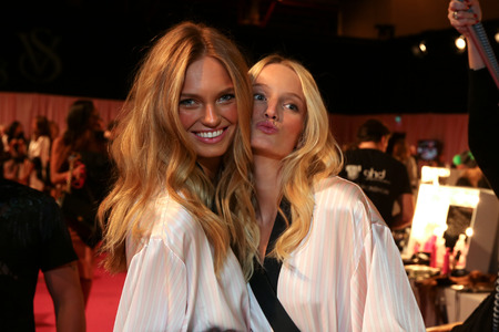 victorias secret show: LONDON, ENGLAND - DECEMBER 02: Romee Strijd and Maud Welze backstage at the annual Victorias Secret fashion show at Earls Court on December 2, 2014 in London, England.