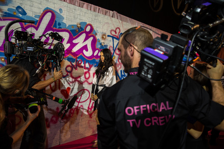 victorias secret show: LONDON, ENGLAND - DECEMBER 02: Official TV Crew working backstage at the annual Victorias Secret fashion show at Earls Court on December 2, 2014 in London, England. Editorial