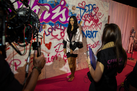victorias secret show: LONDON, ENGLAND - DECEMBER 02: Official TV crew shooting Adriana Lima backstage at the annual Victorias Secret fashion show at Earls Court on December 2, 2014 in London, England. Editorial