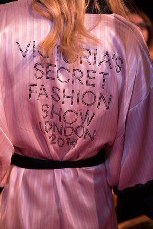 victorias secret show: LONDON, ENGLAND - DECEMBER 02: VS pink robe backstage at the annual Victorias Secret fashion show at Earls Court on December 2, 2014 in London, England. Editorial