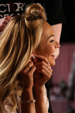 victorias secret show: LONDON, ENGLAND - DECEMBER 02: Candice Swanepoel poses backstage at the annual Victorias Secret fashion show at Earls Court on December 2, 2014 in London, England. Editorial
