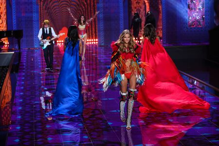 performs: LONDON, ENGLAND - DECEMBER 02: Ed Sheeran performs as model Kate Grigorieva walk the runway at the annual Victorias Secret fashion show on December 2, 2014 in London, England.