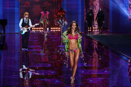 LONDON, ENGLAND - DECEMBER 02: Ed Sheeran performs as model Isabel Goulart walk the runway at the annual Victorias Secret fashion show on December 2, 2014 in London, England.
