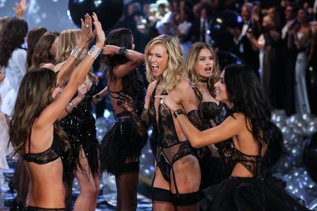 victoria secret: LONDON, ENGLAND - DECEMBER 02: Models (L-R) Alessandra Ambrosio, Karlie Kloss, Adriana Lima, Behati Pinsloo during 2014 VS Fashion Show finale on December 2, 2014 in London, England.