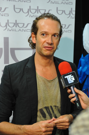 designer label: MILAN, ITALY - SEPTEMBER 17: Fashion designer Manuel Facchini backstage during the Byblos show as a part of Milan Fashion Week SpringSummer 2015 on September 17, 2014 in Milan, Italy.