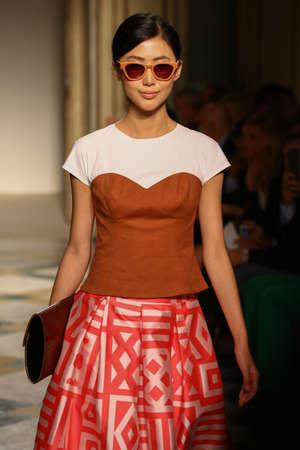 MILAN, ITALY - SEPTEMBER 17: A model walks runway during the Chicca Lualdi show as a part of Milan Fashion Week Womenswear SpringSummer 2015 on September 17, 2014 in Milan, Italy. Sajtókép