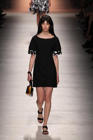 MILAN, ITALY - SEPTEMBER 19: A model walks the runway during the Blumarine show as a part of Milan Fashion Week Womenswear SpringSummer 2015 on September 19, 2014 in Milan, Italy