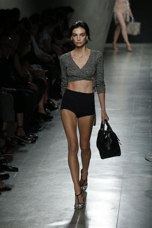 MILAN, ITALY - SEPTEMBER 20: A model walks the runway during Bottega Veneta show as a part of Milan Fashion Week Womenswear SpringSummer 2015 on September 20, 2014 in Milan, Italy