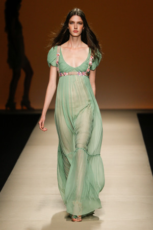 MILAN, ITALY - SEPTEMBER 17: a model walks the runway during the Alberta Ferretti show as part of Milan Fashion Week Womenswear SpringSummer 2015 on September 17, 2014 in Milan, Italy.